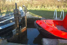 Paddle open, boat going down. Take care to keep the front of the boat clear of the gates